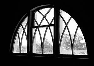 Original demi-lune window on the third floor.